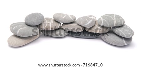 pebble fence isolated on white - stock photo