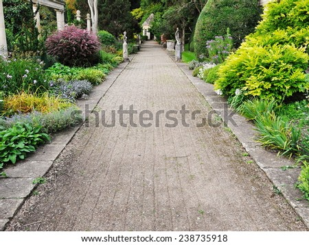 Pebble Pathway through a Beautiful Garden - stock photo
