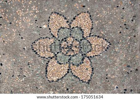 Pebble stone flooring texture with decoration - stock photo