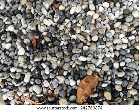 pebble stones background. closeup of stones texture - stock photo