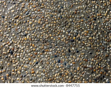 Pebble stones texture background as balinese pond surface's decor ornament - stock photo
