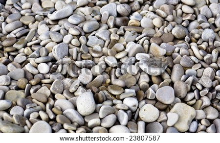 Pebbles and rocks along the shoreline on Lake Michigan. - stock photo