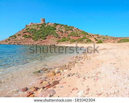 pebbles and sand in Porticciolo beach, Sardinia