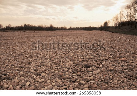 Pebbles and stones along a river - stock photo