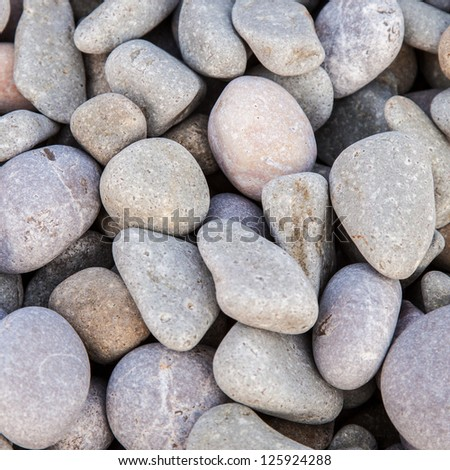Pebbles as a background stony texture, in a square - stock photo