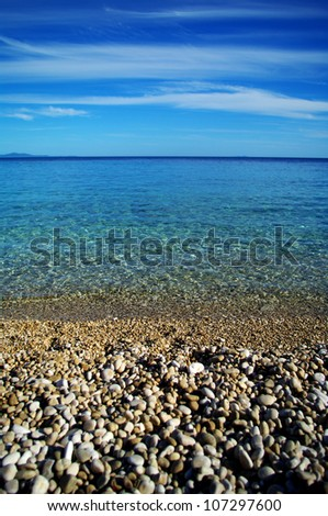Pebbles beach and cristal clear sea