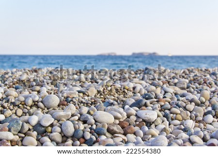 pebbles beach, mediterranean sea,  - stock photo