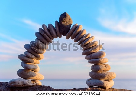 Pebbles in the form of a arch on the coast - stock photo