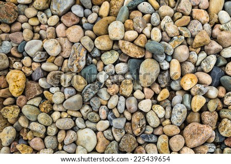 Pebbles of varying size and color - stock photo
