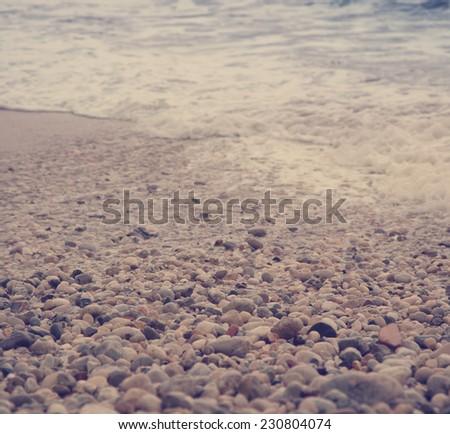pebbles on the sea shore, selective focus - stock photo