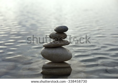 pebbles on top of each other in the sea