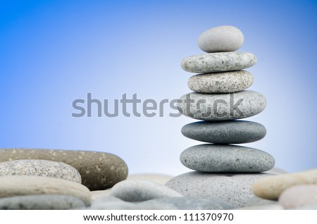 Pebbles stack against gradient background - stock photo
