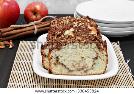 Pecan, apple and cinnamon loaf cake, homemade. - stock photo