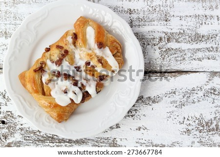 Pecan Danish vanilla frosting on wooden boards painted white - stock photo