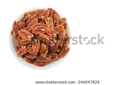 Pecan nut in a white bowl over white background - stock photo