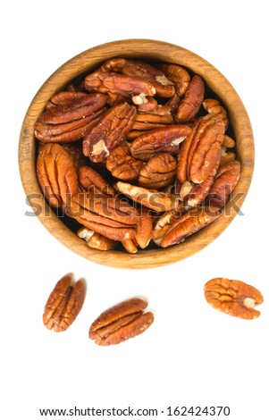 pecan nuts in a wooden bowl - stock photo