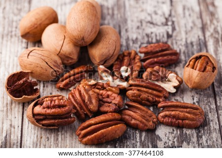 Pecan nuts on a wooden table - stock photo