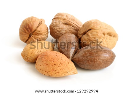 Pecan nuts, walnuts and almonds on a white background - stock photo