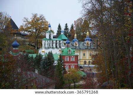 PECHORA, RUSSIA - OCTOBER 19, 2014: Cloudy October day in the Pskov-Pechora monastery - stock photo