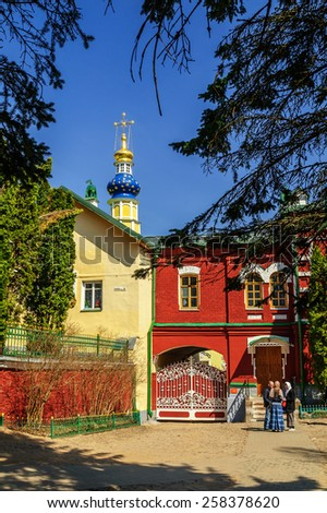 PECHORY, RUSSIA - MAY 4,2013.  The Church of Lazarus  - Holy Dormition Pskov-Caves Monastery  on the Easter Eve. - stock photo