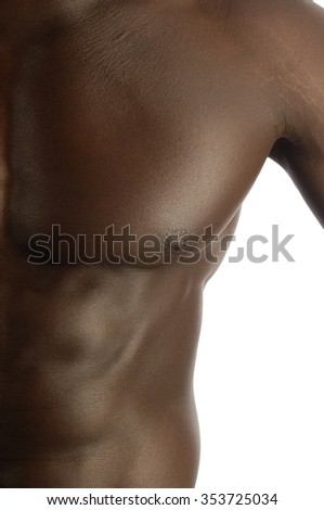 pectoral muscle of a black man with a muscular body, white background.