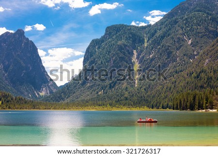 Pedal boat on Lake Dobbiaco (Toblacher See) in the Dolomites, Italy