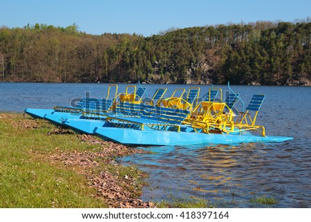 Pedal boats on a lake. Hracholusky dam in Czech republic, European Union. - stock photo