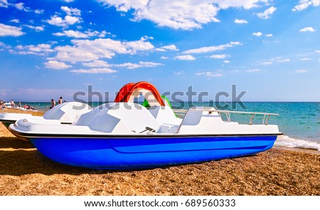 "pedal boats on the beach opposite the aquapark ""banana Republic"" between the cities of Saki and Evpatoria,Crimea,21-07-2017"