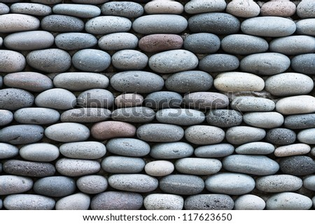 Peddle stone wall texture background - stock photo