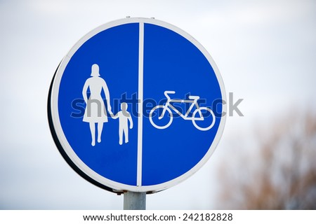 Pedestrian and bicycle shared road sign. Road sign for pedestrians and cyclists who have their own lane. - stock photo