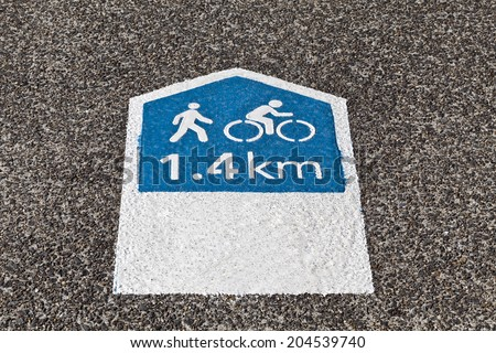 Pedestrian and cyclists footpath sign indicating the distance in Km to the nearby park - stock photo
