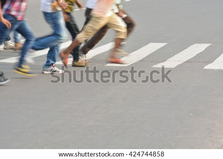 Pedestrian are crossing in zebra crossing.