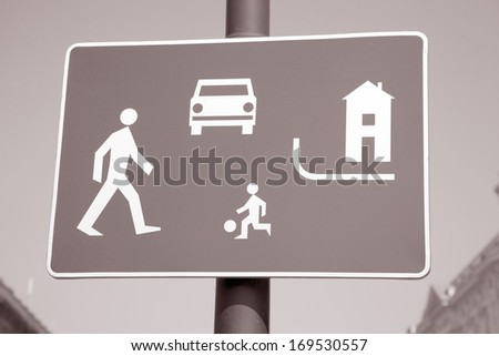 Pedestrian Area Sign in Urban Setting With Blue Sky Background