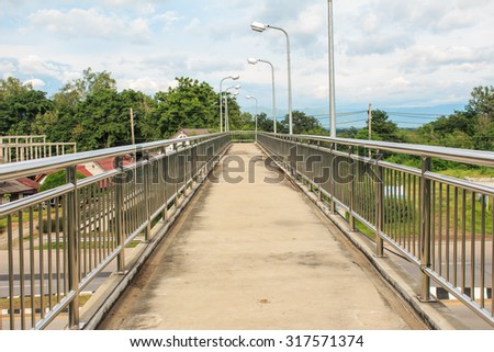 Pedestrian bridge made â??â??of stainless in country - stock photo