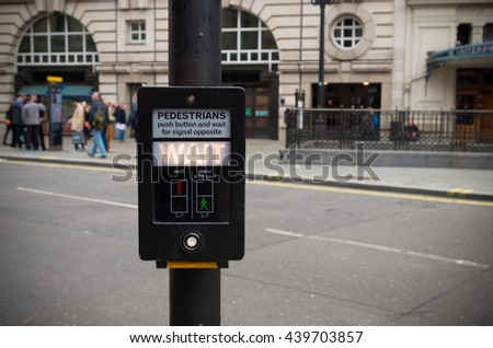 pedestrian button saying Wait in London, england