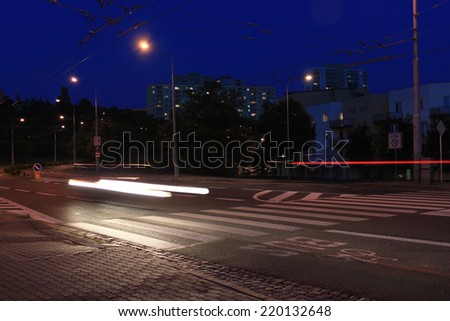 pedestrian crossing at night, Long exposure in night traffic on road and pedestrian crossing - stock photo