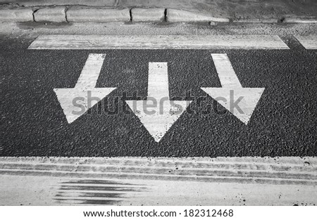 Pedestrian crossing road marking. Arrows and lines on asphalt