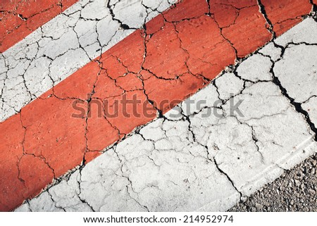 Pedestrian crossing road marking, red white lines on asphalt - stock photo