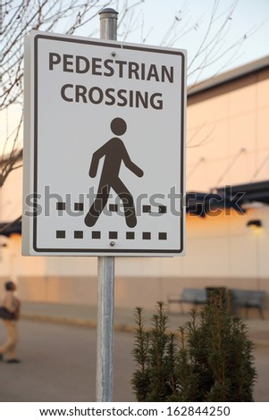 Pedestrian crossing road sign - stock photo
