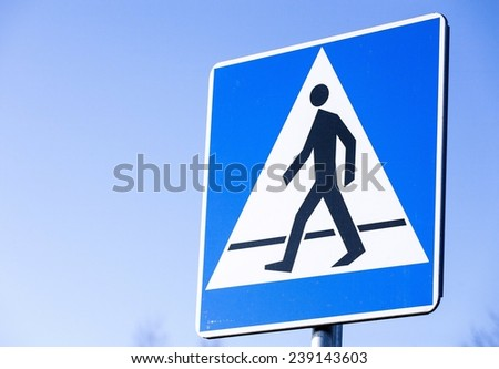 Pedestrian crossing road sign.
