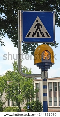 pedestrian crossing sign with flashing led lights - stock photo