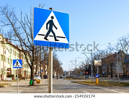 Pedestrian crossing signs on the street. - stock photo