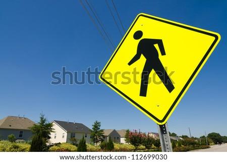 Pedestrian crossing street sign in residential neighborhood - stock photo