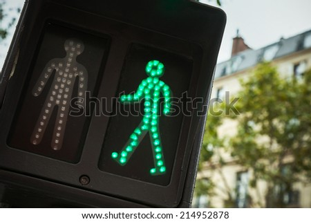 Pedestrian crossing traffic lights show green signal to go - stock photo
