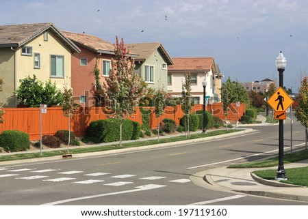 Pedestrian crosswalk in suburban neighborhood - stock photo