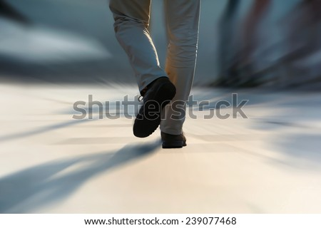 Pedestrian in a big city in a hurry - stock photo