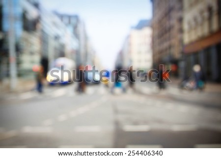 Pedestrian on the big city street road, blurred unrecognizable people in crowd - stock photo