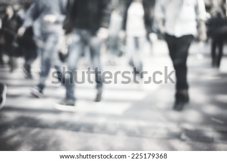 pedestrian on zebra in motion blur - stock photo