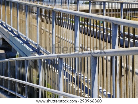 Pedestrian Overpass Walkway with Modern Metal Upright Railings - stock photo