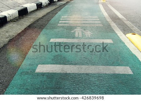 pedestrian passage with bicycle path on the side  - stock photo
